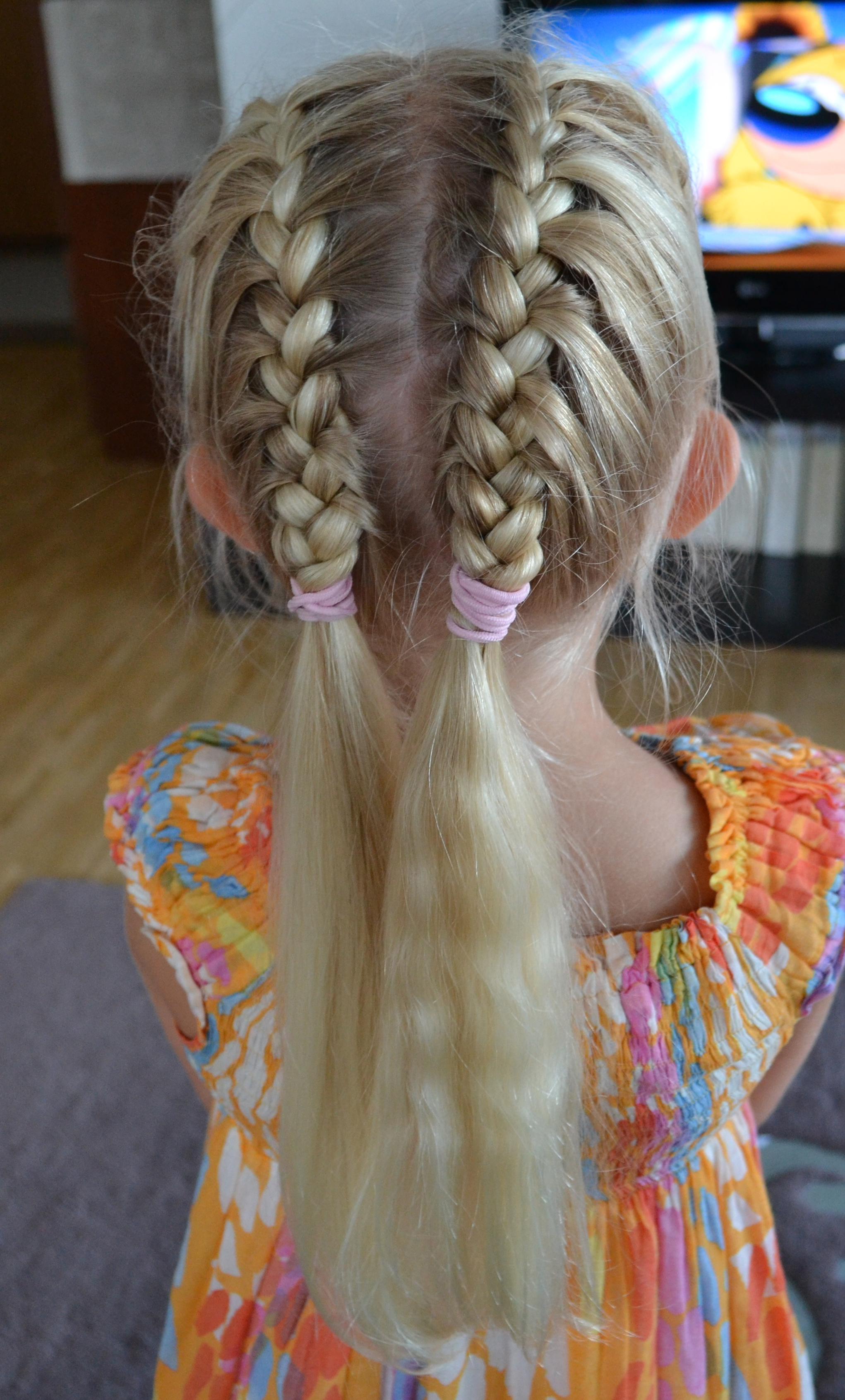 two french braids near the middle parting