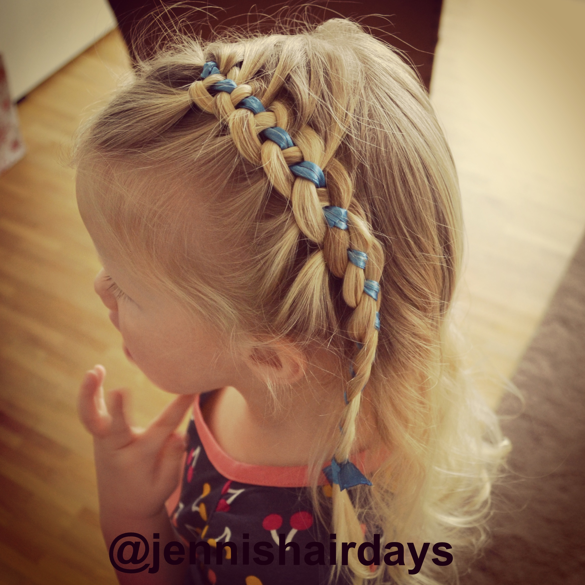 4-strand french braid with blue ribbon