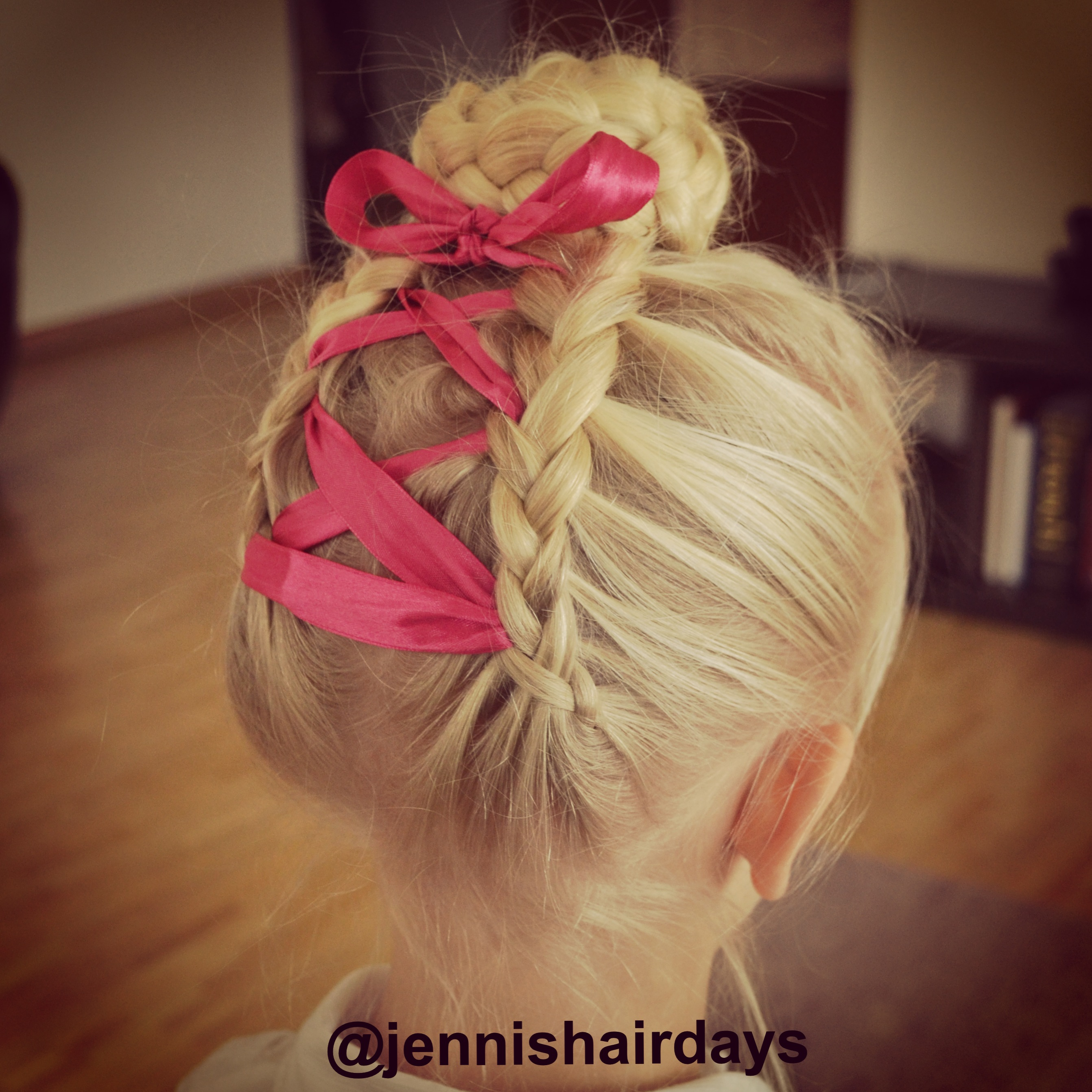 dutch braids into a bun with a ribbon