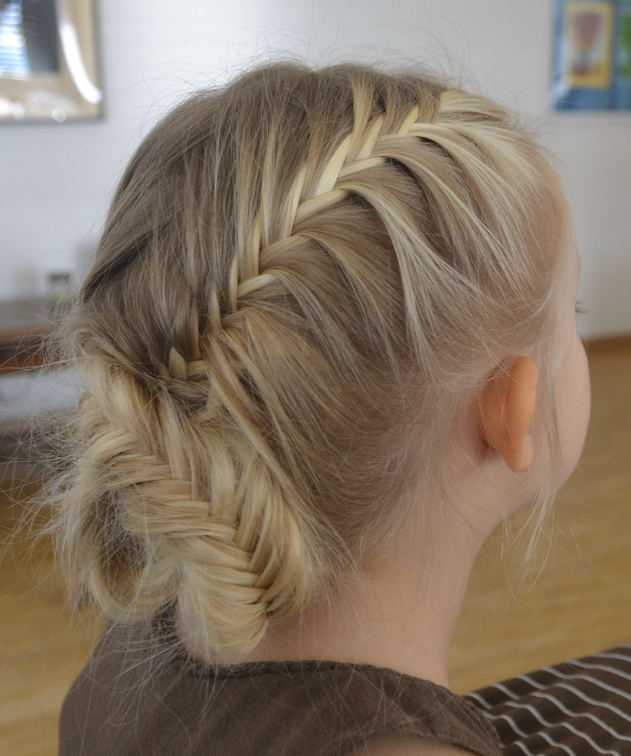 two french fishtail braids crossed over and pinned up